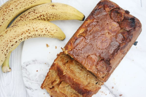 caramel banana bread sliced on a serving plate