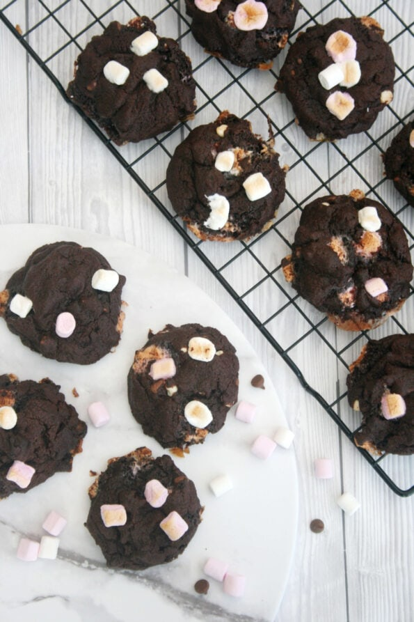 Chocolate marshmallow cookies on a wire rack and serving plate