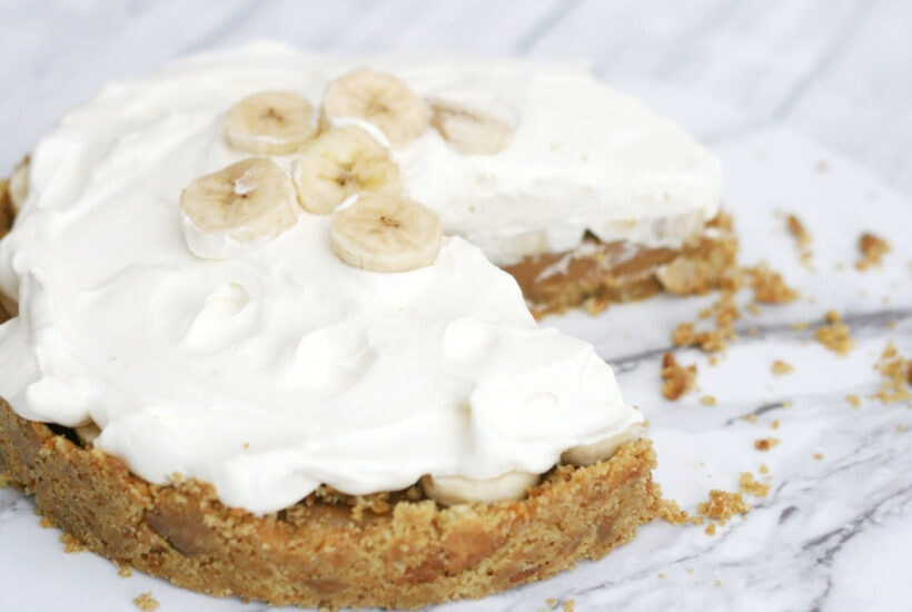 A no bake banoffee pie with a wedge cut out