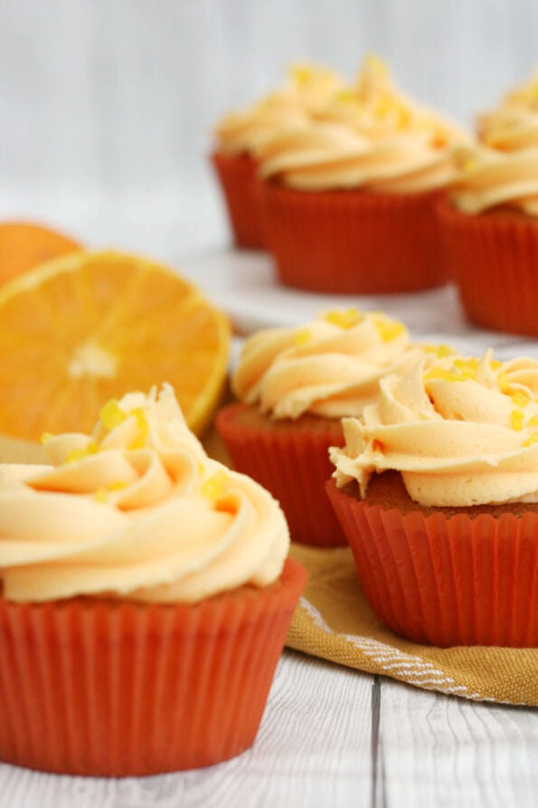 Orange cupcakes on a serving plate