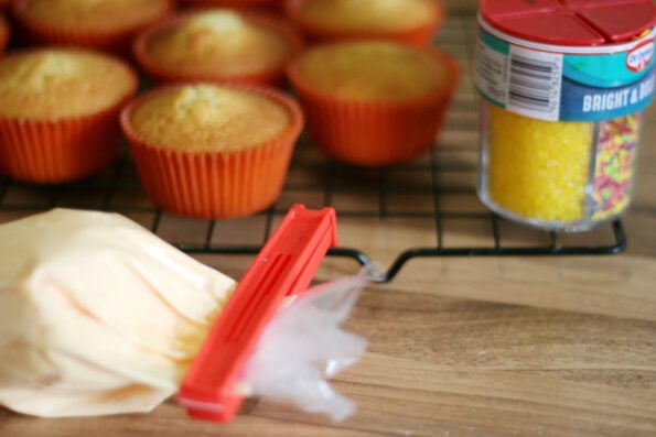 orange cupcake icing in a icing bag with a clip