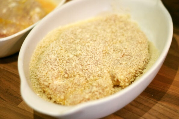 chicken covered in panko breadcrumbs in a dish