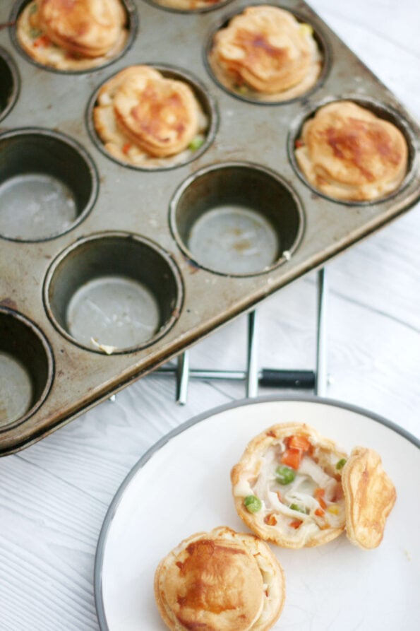 Mini chicken pot pies on a plate an in a muffin tin