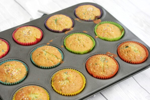 funfetti cupcakes before they're decorated in a muffin tray