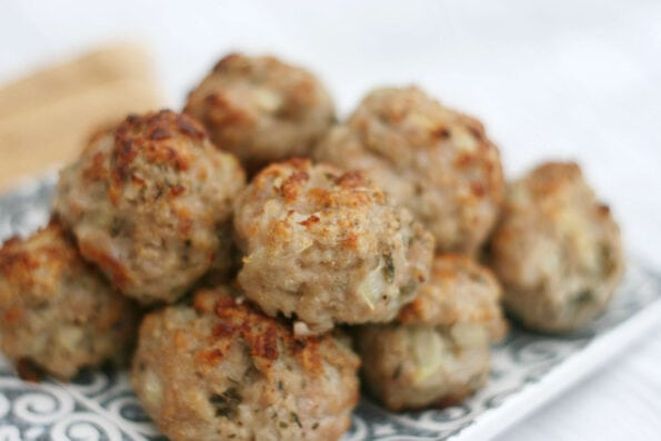 sausage meat stuffing balls on a serving plate