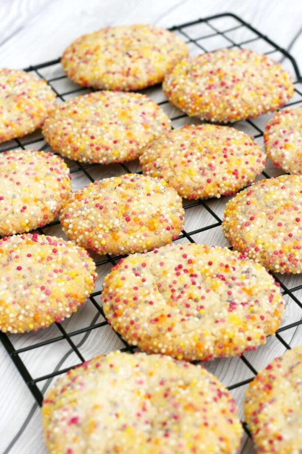 Sprinkles cookies on a wire rack