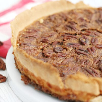 pecan pie with some pecans on the side.