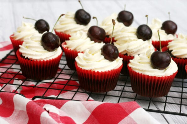 Black Forest cupcakes on a wire rack