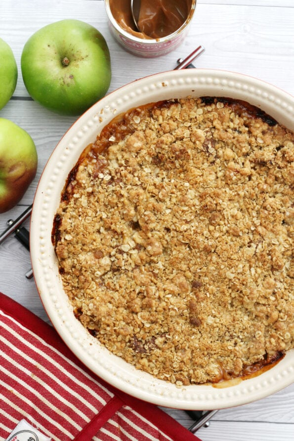 caramel apple crumble next to some apples
