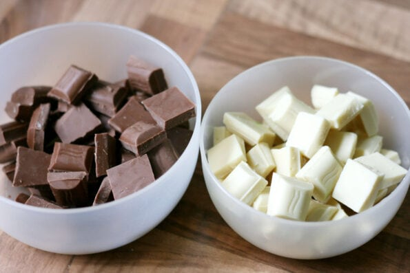 milk chocolate and white chocolate in two bowls